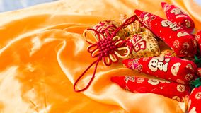 Happy New Year blessing bags, wishful knot, Chinese knot, meaning booming peppers.  Royalty Free Stock Images