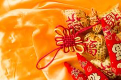 Happy New Year blessing bags, wishful knot, Chinese knot, meaning booming peppers.  Royalty Free Stock Photography