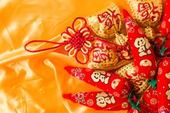 Happy New Year blessing bags, wishful knot, Chinese knot, meaning booming peppers.  Stock Image