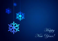Happy New Year on blue background. Christmas snowflake hanging on blue background. Happy New Year Stock Photo
