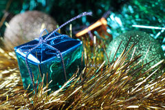 Happy New Year. Blue box 2. Bright blue Christmas box against multi coloured ornament Royalty Free Stock Photography