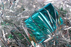 Happy New Year. Blue box. Bright blue Christmas box against silver ornament Stock Images