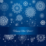 2016 - happy new year. Blue celebration background with hand drawn snowflakes Stock Photography