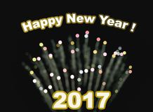 Happy new year 2017. Blurry bokeh fireworks in background Stock Photography