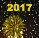 Happy new year 2017 with blurry bokeh fireworks in dark backgrou Royalty Free Stock Images
