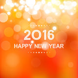 Happy new year 2016 in bokeh and lens flare pattern on summer orange background Royalty Free Stock Photo