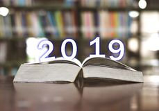 Happy New Year 2019 on books in the library. royalty free stock photo