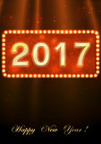 Happy New Year 2017. Bright Christmas greeting card with gold numbers 2017 on a red background with bokeh Stock Image
