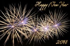 Happy new year 2018 text of gold color and fireworks Royalty Free Stock Photography