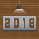 Happy New Year 2018 on brown brick floor and light shines. Happy New Year text 2018 on brown brick floor and light shines Stock Images
