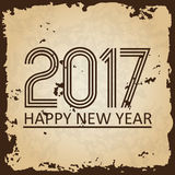 Happy new year 2017 on brown old paper with ragged edges background eps10. Happy new year 2017 on brown old paper with ragged edges background Stock Photography