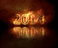 Happy new year. Burning number 2014 reflecting in the water at night Royalty Free Stock Images