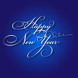 Happy New Year calligraphic lettering on blue background Stock Photo