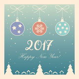 2017 Happy New Year. Calligraphy lettering greeting card with Christmas balls, Christmas tree, snowflakes, falling snow, sparkles, light effect. Winter Holiday royalty free illustration