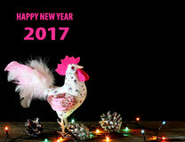 Happy New Year  2017 card background with hand made craft rooster. Happy New Year 2017 on the Chinese calendar of rooster template card with hand made craft pink Royalty Free Stock Photography