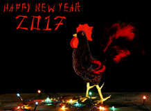 Happy New Year  2017 card background with hand made craft rooster. Happy New Year 2017 on the Chinese calendar of rooster template card with hand made craft red Stock Photos