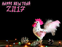 Happy New Year  2017 card background with hand made craft rooster. Happy New Year 2017 on the Chinese calendar of rooster template card with hand made craft Stock Photos