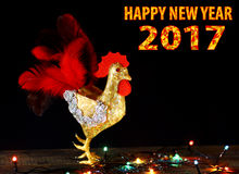 Happy New Year  2017 card background with hand made craft rooster. Happy New Year 2017 on the Chinese calendar of rooster template card with hand made craft Stock Photography