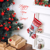 Happy New Year Card. Beautiful decorated room with Christmas tree and presents under it. Winter holidays theme. Royalty Free Stock Photo