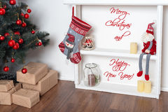 Happy New Year Card. Beautiful decorated room with Christmas tree and presents under it. Winter holidays theme. Royalty Free Stock Images