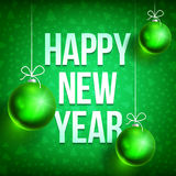 Happy new year card-02. Happy New Year with christmas ball on green background. Christmas related ornaments objects on color background. Greeting Card Ready for Stock Photography