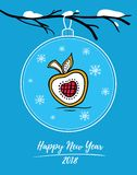Happy New Year 2018 card with Christmas ball on snowy branch. Christmas ball with painted gingerbread in form of apple. Holiday card with Christmas ball on snow Stock Photo