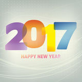 Happy New Year card with color typography `2017`. CMYK colors. Happy New Year card with color translucent typography `2017` on grey background. Vector graphic Stock Photo