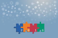 Happy new year card of colrful puzzle pieces. Four colorful puzzle pieces with the numbers 2016 are on the trendy blue gradient background with light Stock Photography