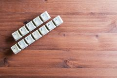 Happy new year card concept on computer keyboard keys on a woode. Happy new year card concept. Holiday technology concept. Flat lay view from above on the table Royalty Free Stock Photo