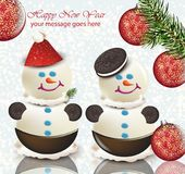 Happy New Year card with cute snowmen. Happy Holidays wishes with Sweet cookie desserts Royalty Free Stock Photo