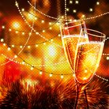Happy New Year Card with glasses of champagne. Holiday golden background and glasses of champagne Stock Image
