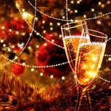 Happy New Year Card with glasses of champagne. Holiday golden background and glasses of champagne Stock Photo