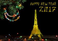 Happy New Year card with Gold yellow Model of the Eiffel tower in Paris Royalty Free Stock Photography