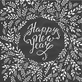 Happy new year card. Hand lettering with floral. Design on chalkboard Royalty Free Illustration