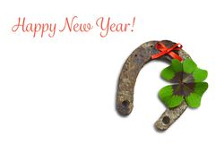 Happy New year card with horseshoe and lucky clover isolated on white. Background Stock Images