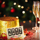 Happy new year card leaning on gold party hat Royalty Free Stock Image