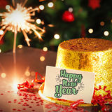 Happy new year card leaning on gold party hat Royalty Free Stock Photos