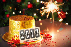Happy new year card leaning on gold party hat Stock Image