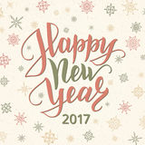 Happy new year card. Lettering over background with snowflakes. Happy new year 2017 card. Retro style lettering over background with snowflakes. Christmas and Stock Images