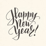 Happy new year card. Lettering over old paper background. Royalty Free Stock Photography