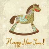 Happy New year card. Rocking horse Happy New year card Stock Image