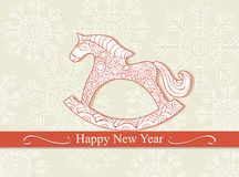 Happy New Year card with a rocking horse. Happy New Year card with a cute cartoon childs rocking horse above a banner with the seasonal greeting on a background vector illustration