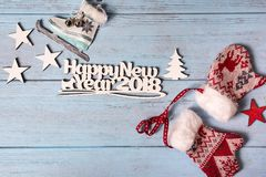 Happy 2018 New Year card with ice skates and mittens Stock Photo