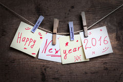Happy New Year card on wooden background Royalty Free Stock Image