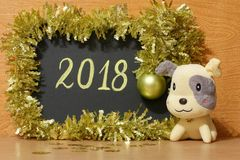 Happy 2018 New Year card - Yellow dog Stock Photos Royalty Free Stock Images