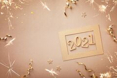 Happy New Year celebration card with golden numbers 2021 and Christmas decorations