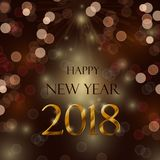 Happy new year 2018. Celebration concept with bokeh ligths and stylize golden and brown text on brown background Royalty Free Stock Image
