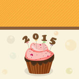 Happy New Year celebration with cup cake. Happy New Year 2015 celebtration with cup cake on stylish background Stock Image