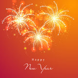 Happy New Year 2015 celebration with fireworks. Happy New Year 2015 celebration greeting card design with beautiful text on shiny fireworks decorated orange Royalty Free Stock Photos