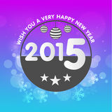 Happy New Year 2015 celebration greeting card. Happy New Year 2015 celebration greeting card design with stylish text in rounded frame and hanging Xmas Balls on Stock Image